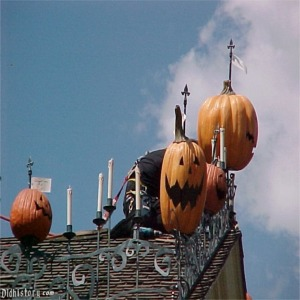 Technician Installing Jack-O-Lanterns And Candles