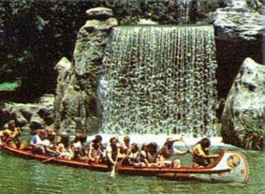 Guests Paddling In Front Of Falls