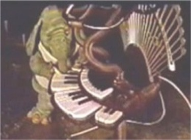 Hooter Playing Keyboard Synthesizer