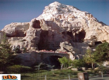 Matterhorn With Bobsleds Crossing Arch Bridge