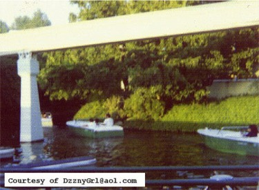 Motor Boat Cruise Passing Under Monorail