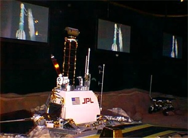 JPL Display With Rocket Launch Video In Background