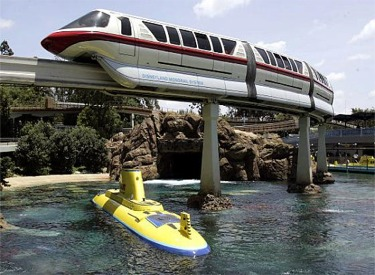 Monorail Red Passing Over Finding Nemo Submarine