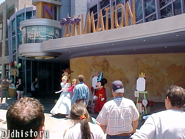 Mickey and Cinderella In Front Of Art In Animation