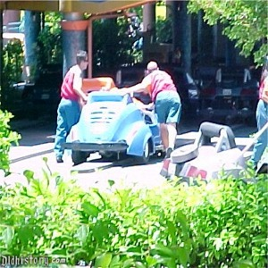 Castmembers Pushing A Car