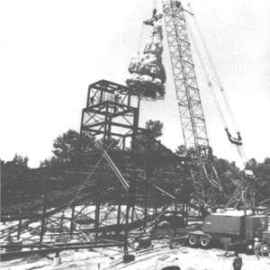 Crane Lifting Top Butte In Place