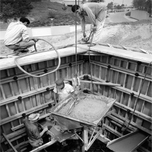 Pouring Concrete For Foundation Of House Of The Future