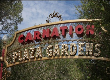 Carnation Plaza Gardens Sign