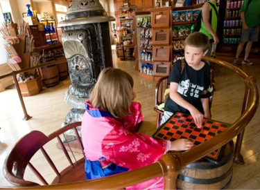 Children Playing Checkers At Market House