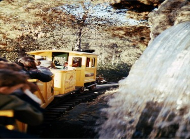 Mine Train Passing Waterfall