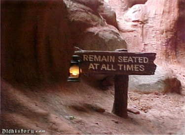 Remain Seated At All Times Sign At First Lift
