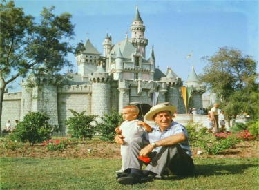 Walt Disney Sitting In Front Of Sleeping Beautys Castle