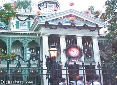 Front Of Haunted Mansion With Christmas Clock